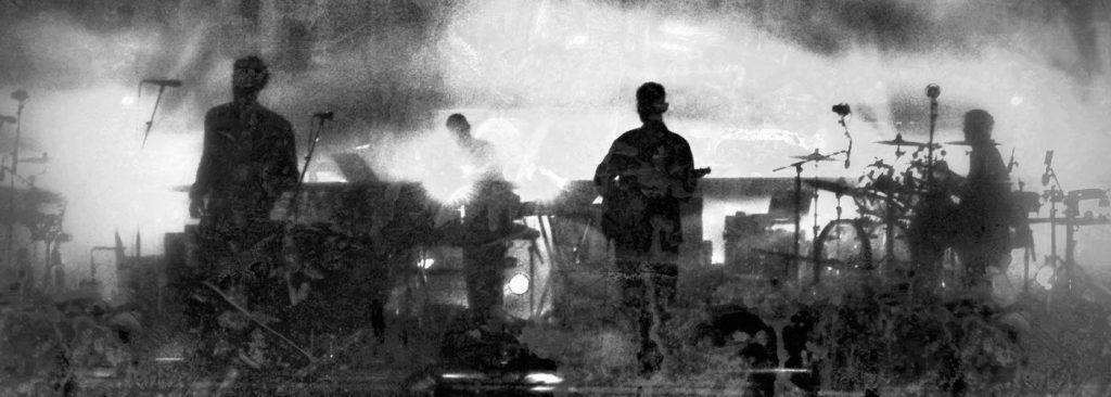 group on stage singing making music